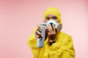 Canva - Man in Coveralls Holding Spray Bottle